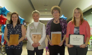 Recipients of the 2014 Marquette County Outstanding Volunteer Awards stand with plaques presented to them by the Volunteer Coordinators of Marquette County during the organization's annual volunteer recognition event April 5 at Westwood Mall in Marquette. Pictured from left are Madison Touchinski, recipient of the Youth Volunteer Award; Joan Zbacnik, recipient of the Adult Volunteer Award; Jeanette Maki, recipient of the Volunteer of the Year Award and Sarah Hujar, recipient of the Michael D. Nunnally Northern Michigan University Student Volunteer Award. Not pictured are St. Vincent de Paul Society of Ishpeming volunteers, recipients of the Volunteer Organization Award and Heather Modell, recipient of the Adult Volunteer Award.